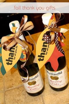 love for a gift at thanksgiving - bottle of sparkling cider tied with autumn bows and leaves