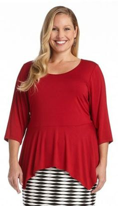 PLUS SIZE RED 3/4 SLEEVE PEPLUM TOP This Karen Kane peplum top is an updated classic. Constructed in a stretchy spandex jersey material, it features a wide scoop neck, 3/4 sleeves and a handkerchief hem that will skim over hips for a flattering effect. Its simple design allows you to accessorize with most anything for an easy casual to dressy transformation. #Plus_Size #Red#Peplum_Top #Karen_Kane