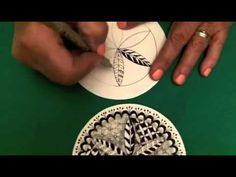 Video shows how to tangles the mandala and how to draw the tangle:Snood