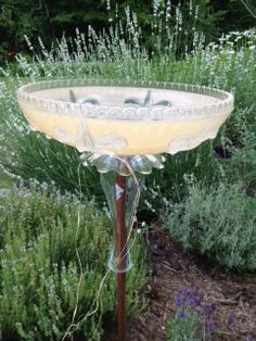 This is one of the vintage glass light shades I repurposed into a bird… :: Hometalk