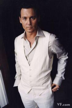 Johnny Depp dapper in white vest and grey custom dress shirts