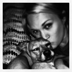Carrie Underwood and her dog Penny sharing snuggles. See more photos here >> http://my.gactv.com/great-american-pets/Celebrity-Pets/Carrie-Underwood-/detail.esi?oid=31158574