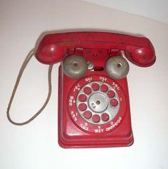 Vintage Red Metal Telephone Toy via Etsy.