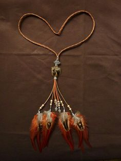 Feather necklace, made by Delilah Sieraden Boutique. https://www.oorbellenboutique.nl #feathers #necklace #feathernecklace #handmade #bohofashion #jewelry #musthave #bohochicstyle #gypsysouls #sieraden #beautiful #gypsy #native #nativeamerica