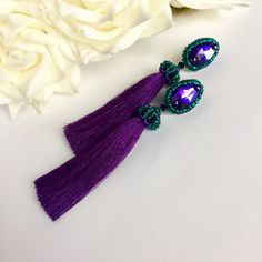 A personal favorite from my Etsy shop https://www.etsy.com/listing/531296808/emerald-purple-beaded-long-tassel