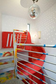 Like a spiral staircase, a spiral slide can fit into a tighter space where you may not have all of the room for the long run.
