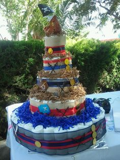 pirate themed diaper cake- gold coins, pirate ship bath toy, tooth pick swords spray painted black... and more