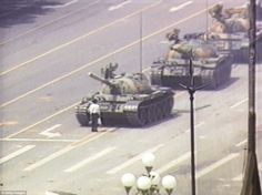 Defiance: On June 5, 1989 this man bravely stood in front of a Chinese tank following the Tiananmen Square massacre. Chinese troops had attacked pro-democracy demonstrators camped on the plaza