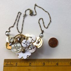 Vintage Button Necklace with Brassy Gold and by buttonsoupjewelry                                                                                                                                                                                 More