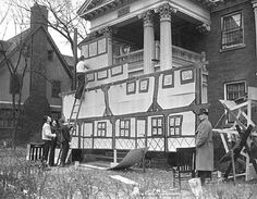 A University of Minnesota Fraternity takes part in decorating the front of their house during Homecoming in 1937; a tradition that's carried on to this day.