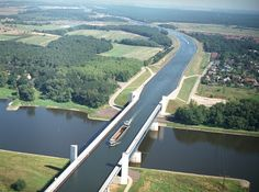 The Magdeburg Water Bridge is a navigable aqueduct in Germany that connects the Elbe-Havel Canal to the Mittelland Canal, and allows ships to cross over the Elbe River. At 918 meters, it is the longest navigable aqueduct in the world.