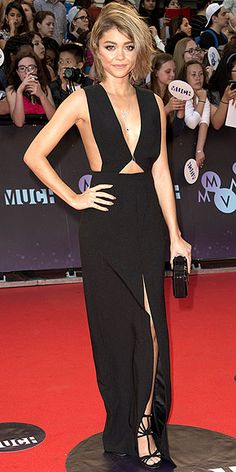 SARAH HYLAND | in a plunging black Solace London dress with cutout detailing, which she accessorizes with a black structured Rauwolf clutch and a delicate Lorraine Schwartz body chain, at the Much Music Video Awards in Toronto.