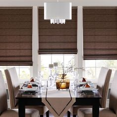 Cascading from an elegant valance, Romanelle Roman Shades offer complete control over every element of light and design.