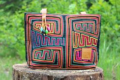 Discover unique handmade leather handbags, purses, messenger bags, backpacks and more on Seal of zAz. A perfect blend of leather and multi-coloured Mola for a one of a kind bag. Leather Bags, Leather Handbags, Cool Gifts, Wallets, Purses, Cool Stuff, Unique, Handmade, Art