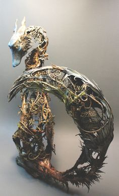 Ellen Jewett's strange, elaborate, poetic hybrid creatures fuse fauna with flora and even machine. Intricate branches and herbage flower off of the delicate limbs of these mysterious beings. Often exuding a sadness, or bearing a fantastic burden reminiscent of Dali's elephants, they are beautiful and have an inimitable grace.