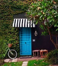 ok, some of my fav things all together - b graphics, ivy growing on an exterior wall, cute hanging lantern & blue door. Have a door on the fence just for fun. Blue Lantern, Love Your Home, Outdoor Living, Outdoor Decor, Outdoor Spaces, New Home Designs, Entryway Decor, Curb Appeal, Beautiful Homes
