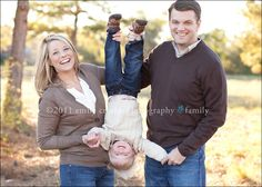 I love these family photos with the parents hanging the kid upside down. They are so happy.