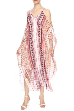 Open shoulder kaftan style maxi dress with a v-neckline and 3/4 sleeves. Tribal Open Shoulder Maxi by Charlie Jade. Clothing - Dresses - Maxi Clothing - Dresses - Printed Canada