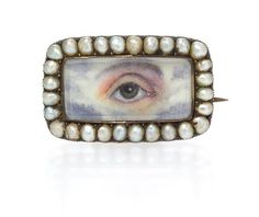 An Antique Yellow Gold and Seed Pearl Lover's Eye Brooch, 2.50 dwts.