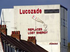 Lucozade sign in Brentford. This has just been replaced with a big ugly screen. What a pity! Lucozade, Brentford, Typography, Lettering, Vintage London, London Photos, Local History, Shop Signs, Historical Photos