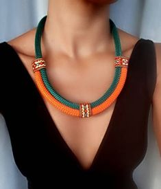 Best 10 This necklace is classy, feminine and elegant. It can be worn for any occasion. – Made to order – Handmade – Lightweight to wear – Materials: orange and green rope, ribbon, silver magnetic clasp – Length of the necklace: 45 cm / inches – Shipp Knot Necklace, Green Necklace, Beaded Necklace, Pendant Necklace, Wire Earrings, African Necklace, African Jewelry, Ethnic Jewelry, Jewelry Stores Near Me