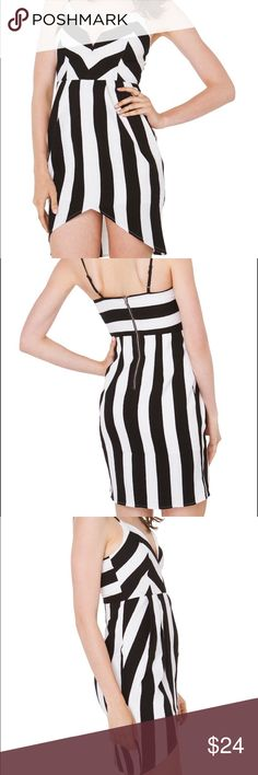 """Akira Black Label Stripe Summer Dress Small Never worn, new with tags, Akira Black Label """"line up"""" striped black and white dress with asymetrical/high low/fluted gen. Has adjustable spaghetti straps and a back zipper closure. Very beautiful classy dress for the summer! AKIRA Dresses High Low"""