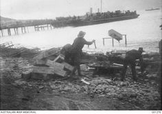 Gallipoli Peninsula, Turkey. 17 December 1915. Three soldiers breaking up the rum cases.