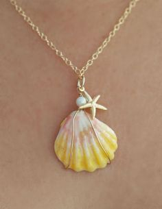Sunrise Shell Necklace with14kt Gold Filled chain fresh water Pearl and Starfish drop.