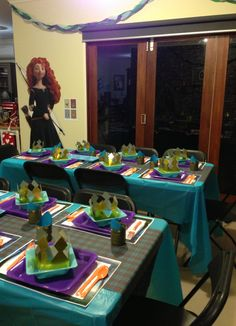 The tartan table runners were custom made fabric printed from an image of the DunBroch clan tartan from the movie. The pattern was smaller than in the movie, but the same colours :) Also, the cardboard Merida movie stand on the wall added a nice touch :) 6th Birthday Parties, Third Birthday, Birthday Ideas, Archery Party, Bday Girl, Baby Party, Happy Kids, Table Runners, Brave