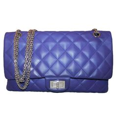 Chanel Indigo Lambskin Reissue 2.55 Size 227 Handbag - circa 2012 | From a collection of rare vintage crossbody bags and messenger bags at https://www.1stdibs.com/fashion/handbags-purses-bags/crossbody-bags-messenger-bags/