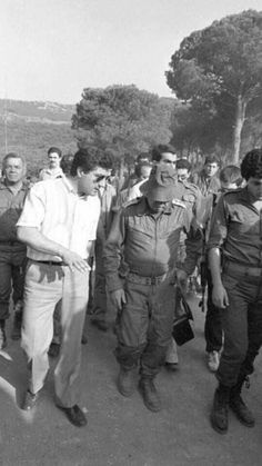 June, 1982-Invasion of Lebanon | Bachir Gemayel with Rafael Eitan [Chief of Israel  Military Forces] walk in the east part of the Green Line of Beirut during the Israeli's siege of west Beirut. Lebanon.