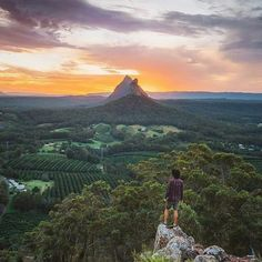 This is where I live - one of my favourite places to hike, a few minutes from my house. Climber on Mt Ngungun, looking towards the peaks of Mt Coonowrin and Mt Beerwah. Glass House Mountains, QLD, Australia.