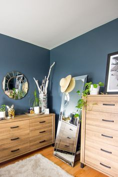The recipe for creating this stylish bedroom design for yourself is easy, with help from blogger Design Sponge. Simply combine wood furniture with industrial finishings, fresh greenery, and a bold coat of dark teal paint.