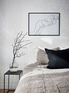 grey linens black pillows white bedroom