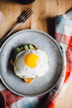 Creamy avocado meets pungent sauerkraut and a warm, buttery, sunny-side-up-egg all on crunchy gluten free sourdough toast.