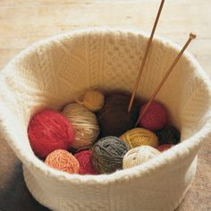 This pliable 10-inch-tall knitting basket was made from a snowy Aran sweater. Its sides came from the body of the sweater; its base was cut from the sleeves. For a primer on felting, see our instructions.