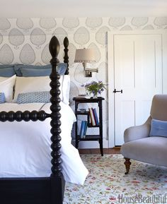 Master bath wallpaper? Love bed too. Beautiful bedroom with wallpaper and spindle bed
