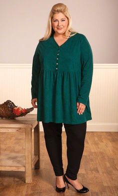 The updated styling of our Arabella Babydoll Top provides structure to the softest cotton.      Available in Channel Island (pictured), Maroon, Preserves, Saffron, San Juan and Wild Plum!     Shown with our  Skinny Jeans !      Soft jersey knit     Button placket and gentle gathers at empire waist    V-neckline      Long sleeves      100% cotton      Machine wash      37 long in size 5X        - Made in USA         Pricing:  1X-5X - $99 6X-7X - $109