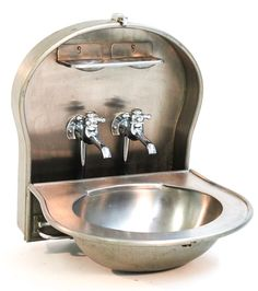 Fold-out Train Sink. Circa 1910. They're called Pullman sinks, originally designed for use on Pullman overnight passenger rail cars. Found some newer versions of them online, but many many more $$ than I want to spend for a sink. Thinking about coming up with a DIY version of this for the tiny house bathroom.