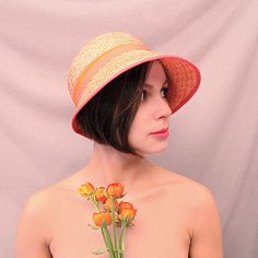 assymetric coral cloche. You will wear this to a garden party. You won't meet the love of your life, but you will find someone with whom you flirt.