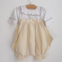 yellow bloomers set c. 1910 fine white cotton shirt trimmed in black edged ruffles attaches to pale yellow gauze bloomers. buttons high ju...