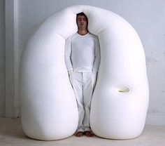 Unusual bed from Ernesto Neto allows you to sleep standing up. I need this in the office. The sofa just isn't doing it anymore.