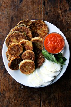 These crispy rounds of eggplant parmesan are irresistible, and with a few slices of cheese, some bread, sauce, maybe some prosciutto or other cured meats, you can make a meal out of them. Little ones, teary eyed or otherwise, seem to like them, too.