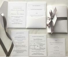 White silver and dove grey wedding invitation suite