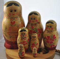 These look a lot like the first sets of nesting dolls in my collection.  Mine were purchased in 1970.