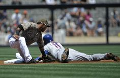 Game #111 8/5/12: Ruben Tejada #11 of the New York Mets is tagged out by Alexi Amarista #5 of the San Diego Padres as he tries to steal second bass during the first inning of a baseball game at Petco Park on August 5, 2012 in San Diego, California. (Photo by Denis Poroy/Getty Images)