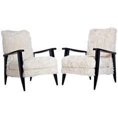 Pair of French 1950s Ebonized Armchairs   From a unique collection of antique and modern armchairs at http://www.1stdibs.com/furniture/seating/armchairs/