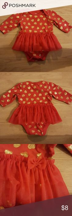 Infant dress Red long sleeve bodysuit with red tutu sewn around the waist. Gold hearts. The tutu has a red bow on the left side. Very good condition. Only worn twice One Pieces Bodysuits