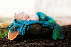 Mermaid Fins This photo is so cute. I love everything about it, the baby, the gorgeous colors of the crocheted mermaid fin, the headband, the blue scarf. So sweet.