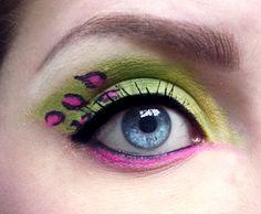 Neon green eyes with fuschia cheetah spots